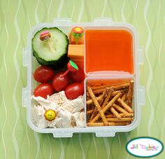 This was a really simple bento put together for her afternoon nutrition break. On one side of the bento box she had some sliced cucumbers, cubed cheese, baby tomatoes and shredded rotisserie chicken. There are cute little picks holding these foods. She also had a container of orange jello and a container of pretzel sticks.