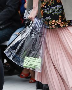 The anti-luxury trend peaks with Céline selling a custom plastic bag. While you'd be forgiven for thinking this was just another runway styling prop...