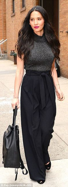 Lunch anyone? Olivia stepped out midday in a sleeveless knit top and billowy trousers...