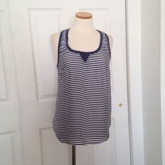 Navy Striped Tank Satin type tank. Navy stripes. Size S. Never worn, excellent condition. PLEASE use the OFFER button  for price negotiations :) 20% off bundles! Purchases are shipped the next business day. Posh rules only.  TRADES!  PAYPAL! LOWBALLERS! Tops Tank Tops