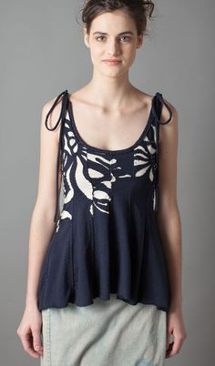 "(Reverse Magdalena Jane Tank )~ Sewn in placement fashion, using reverse applique , this top is fitted at the bust,  flares at the waist, and has straps that tie at the shoulders.  Shown in Navy, with natural under.  Medium: 100% organic,  medium-weight cotton jersey./Dimensions: 26"" from shoulder./Design: Alabama Chanin... $410.00"