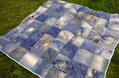 How to use up all those old jeans and worn sheets.   Look closely at this pic of the quilt, squares are cut from all places in the jeans, over the back pockets not just in the legs etc.  And you could get away without using batting.  Quilt / Picnic Inspiration.
