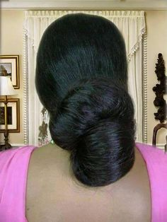 What a beautiful large low bun! Care however should be taken before adopting such hairstyles, as due to it's high static charge, it will cause phlegm to move up in the throat, causing the voice to quaver & a frequent urge to clear the throat. A heavy chabi chhalla with a long & wide hook if inserted at the edge of the pleats of the saree, will reduce this problem as it's hook will activate the acupressure points that act to keep the throat clear. Long Silky Hair, Super Long Hair, Thick Hair, Wedding Bun Hairstyles, Bun Hairstyles For Long Hair, Beautiful Long Hair, Beautiful Buns, Sneha Actress, Curly Hair Styles