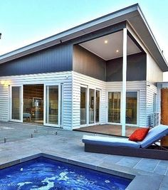 Another interesting application of Scyon Linea™ - this one in the outdoor area of a busy family home. Great for creating contrast, adding texture and enduring the effects of the weather and the water. House Cladding, Facade House, Minimalist House Design, Minimalist Home, Australian Architecture, Architecture Design, Exterior Design, Contrast, Home And Family