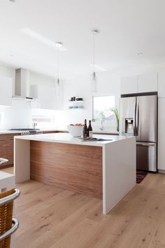 white oak floors, waterfall edge on island, contemporary front wood cabinets