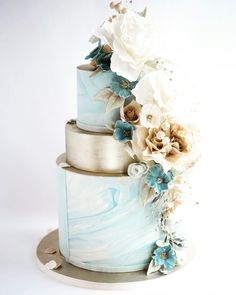 Moody Winter Neutrals Wedding Cake iced with our signature rolled chocolate decorated with our own hand made sugar flowers Sugar Realm Cincinnati wedding Cakes These flow. Amazing Wedding Cakes, Wedding Cakes With Flowers, Elegant Wedding Cakes, Wedding Cake Designs, Flower Cakes, Elegant Cakes, Cake With Flowers, Lace Wedding, Purple Wedding