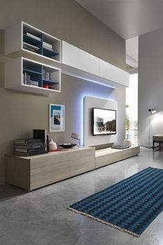 The storage cabinet TV background wall is also very practical now. The design that integrates the cabinet and the TV background is flexible, and different… Living Room Wall Units, Living Room Tv Unit Designs, Living Room Decor, Living Rooms, Tv Unit Decor, Tv Wall Decor, Wall Tv, Tv Wall Cabinets, Modern Tv Wall Units