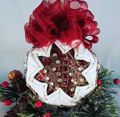 """You can just see this gorgeous quilted keepsake ornament sparkle and reflect the light of the Christmas tree it graces. """"White Christmas Jeweled"""" is a handmade quilted ornament that looks fabulous on a tree in a bowl/basket a mantle decoration on a wreath or in a holiday centerpiece! Beautiful white brocade surrounds a sparkling center of jewels and gold braid. Topped with a pretty red bow.  #OrnamentsByRebecca #NotJustForChristmas #EtsyCIJ2017 #Etsy #EtsySeller #QuiltedFabricOrnaments…"""