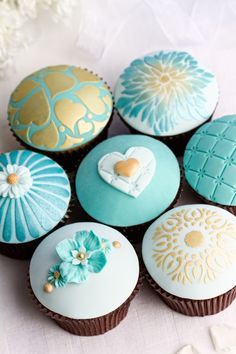 Beautiful cupcakes for a teal and gold themed bridal shower.