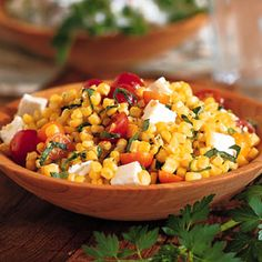 Pan Roasted Corn Salad with Tomatoes and Feta. Had something like this in South Africa and it was delish!