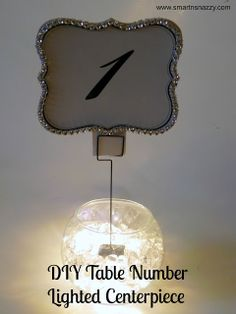 Wedding DIY ~ Table Number Lighted Centerpiece  do u like this? do u like the led light in the bowl? I am not that crazy about it, you? m~