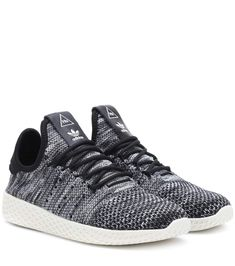 new style d2895 eb3fb Shop Pharrell Williams Tennis Hu sneakers presented at one of the worlds leading  online stores for luxury fashion.