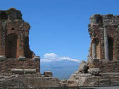 The fantastic view of Mount Etna seen from the Teatro Greco in Taormina.