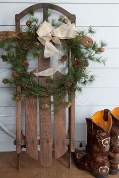Sled with Pine cone wreath