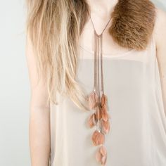 feather necklace by noemiah