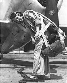 WASP pilot Deanie Parish in front of her P-47 Thunderbolt aircraft, circa early 1940s (tyndall aaf, fl) (deanie looks almost as if she's wearing a marine/navy cloth cap here. i guess that's possible given that it's florida)