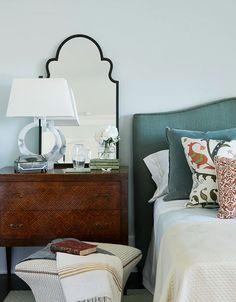 teal headboard, wood nightstand, sophisticated palette
