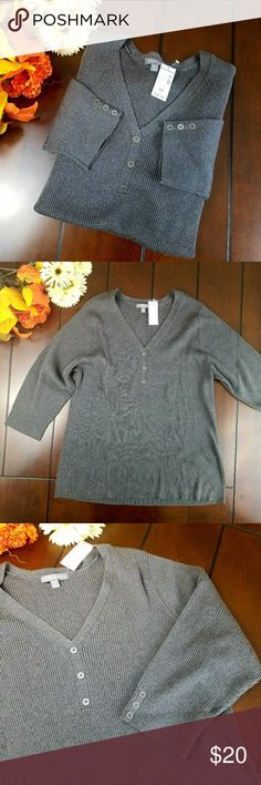 Roz & Ali Plus size V Neck 3/4 Sleeve Sweater 3X This casual sweater by Roz and Ali is available new with tags in size 3X. Features v neck and 3/4 sleeves with accent buttons. 55% cotton 45% acrylic . Hand wash. Gray. Roz & Ali Sweaters