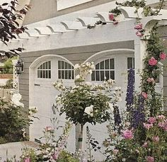 Like the detail of the arch above the garage doors.  The arbor is nice too.  Although I don't have any luck with plants...especially getting them to climb.