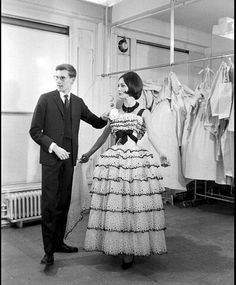 1959 Yves Saint Laurent and Kouka try out placement of flower in the atelier of Maison Dior, photo by Jack Garofalo, Paris