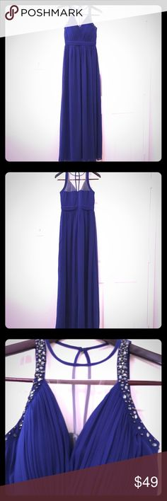 Plunge Neck Maxi Dress with Embellished Details. New without tag evening maxi dress by Little Mistress London. Never worn. Size 4. Regular fit -True to size. Fully lined. Light cup padding. Pleating throughout with hidden back zipper. Romantically soft  and flowing chiffon in rich navy blue with a hint of purple. Truly beautiful color in person. Perfect for special occasions  or wedding event. Let me know if you have any questions. Thanks for your interest. Little Mistress Dresses Maxi