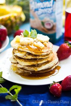 Filled with sliced banana, pineapple chunks, and shredded coconut, these Fluffy Hawaiian Style Pancakes are sure to be a weekend favorite.