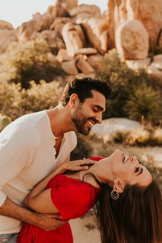A romantic sunset engagement session at Joshua Tree National Park by Carrie Rogers, a California Elopement Photographer.
