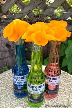 I need a Cerveza! Cinco de Mayo Centerpiece is part of Fiesta bridal shower - Cerveza Centerpieces for Cinco de Mayo First the EASY fácil way Colorful water filled Coronita Bottles, with beauti Mexican Birthday Parties, Mexican Fiesta Party, Fiesta Theme Party, Festa Party, Party Themes, Ideas Party, Mexican Fiesta Decorations, Taco Bar Party, Party Ideas For Adults
