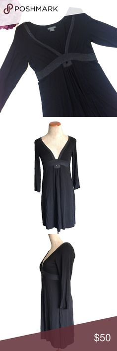 """Armani Exchange Shimmer Trim Jersey A Line Dress Beautiful Jersey Knit a Line dress from A/X Armani Exchage. Long sleeves, keyhole front that gathers, dark shimmery trim on front. Approx flat meas: length 33.5"""", bust 14.5"""", sleeve 18"""". EUC no rips stain or holes, but may have light fading and/or pulling from gentle use. 95% rayon 5% spandex machine wash A/X Armani Exchange Dresses"""
