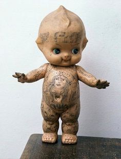 tattooed kewpie doll - best doll ever - I used to do this with my dolls (only the art work left something to be desired)  : )