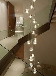 staircase chandelier. Hang from stair case sky light. Maybe faux plants in globes