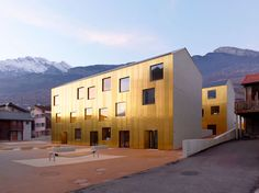 Two buildings are set into the naturally-sloping site. the first building, to the south, accommodates the pre/post-school childcare unit and the nursery, while to the north, the second building houses the crèche. access is from the ruelle du collège, ...