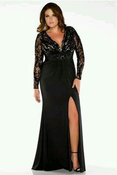 e7a112a8e08 This illusion long-sleeved plus size evening dress has a plunging neckline