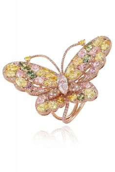 Chopart Butterfly ring in 18k rose gold set with multi-colored fancy cut diamonds (19.31 carats) and one marquise cut diamond (1.51 carats)