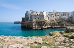 Polignano a Mare   15 Charming Small Towns You Need To Visit In Italy  This comune in southern Italy is located on the Adriatic Sea and has a popular beach. There's also a hotel there called Grotta Palazzese which has a cavernous restaurant that's highly recommended.