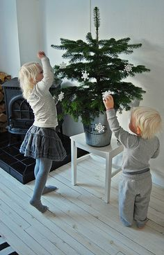 would be sweet to do a tabletop tree with a little present for the boys for each day of december until christmas.