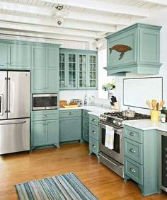 Decorating Kitchen teal kitchen cabinets with glass fronts, marble countertops, subway tile backsplash, beach cottage kitchen remodel - A beach cottage's rundown cook space becomes a year-round haven Teal Kitchen Cabinets, Kitchen Redo, New Kitchen, Maple Cabinets, Kitchen Ideas, Kitchen Designs, Kitchen Backsplash, Kitchen Floor, White Cabinets