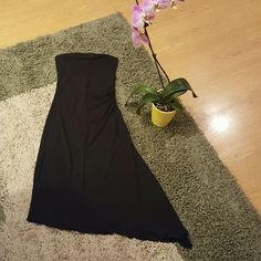 Sexy Black Strapless Tube Top Dress My Michelle Juniors' Size Medium so fits Woman's XS/SM. Very form fitting in all the right places. 100% Polyester for comfortable, stretchy fit.  Diagonal hemline. See pics for measurements.  Overall great condition! No flaws, worn for 2 events. My Michelle Dresses Strapless