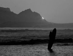 Strand sunset in black & white - by Steven Phyffer. Last piece of the sun visible behind Devils Peak - Table Mountain, Cape Town. #strand #sunset #surfing