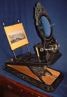 A ZIEGLER DE LUXE STEREOSCOPE    A very rare large Ziegler stereoscope ca 1870.  Heavely decorated.