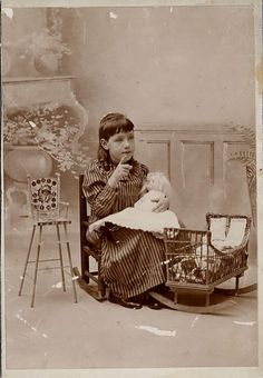 Antique photo of Leona Laycock Scott, age 5 years, and her doll, circa 1880 - 1900.