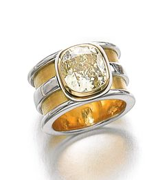 FANCY INTENSE YELLOW DIAMOND RING Collet-set with a cushion-shaped fancy intense yellow diamond weighing 4.04 carats