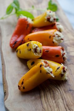 Our stuffed sweet peppers recipe makes a colorful appetizer or a side dish to your meal. Stuffed with pancetta & cheddar, give this recipe a try today! Yummy Appetizers, Appetizer Recipes, Snack Recipes, Snacks, Wedding Appetizers, Vegetable Recipes, Free Recipes, Healthy Recipes, Mini Sweet Peppers