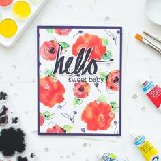 This video tutorial shows you how to create a floral watercolor background using Distress Inks.