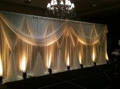draping and lighting could b done behind bridal party table. Can do up lighting or lights behind fabric.