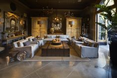 I love the luxury look here --- interesting lighting for my living room