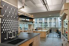 Energy-intensive laboratory spaces are grouped and separated from office and write-up areas by glass partitions that are designed to maximize daylighting and communication and promote student safety. The sloped ceilings also enhance light coming in from the continuous windows.