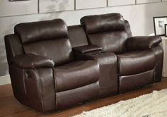 Marille Collection Double Glider Reclining Love Seat with Center Console 9724BRW-2With either the extended stretch of the reclining sofa or soothing rock of the reclining chair, your comfort is taken care of in the Marille Collection. Drop-down cup holders add additional function to the collection. The collection is offered in brown bonded leather match, black bonded leather match, dark brown 100% polyester or taupe 100% polyester.Features:Marille CollectionContemporary StyleTraditional…