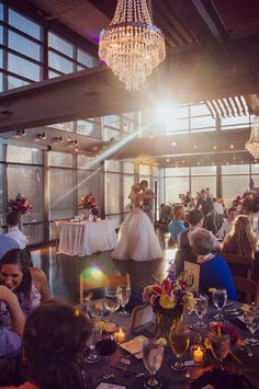 This picture shows exactly why we love the Bridge Building Event Space.  The natural light beaming through those large windows creates the best ambiance and perfect lighting for an evening wedding.  Click the image to learn more about this amazing Nashville wedding facility. Photo credit: IBW Photography