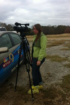 Emily Mowers on a cold winter's day shooting a commercial in the mud for a livestock sale. Sad face.